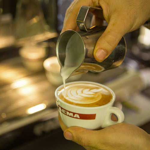 Barista making latte art